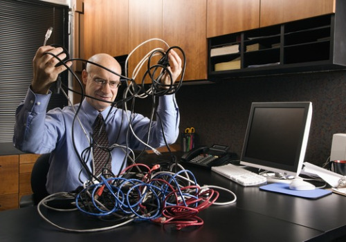 Businessman with computer cables.